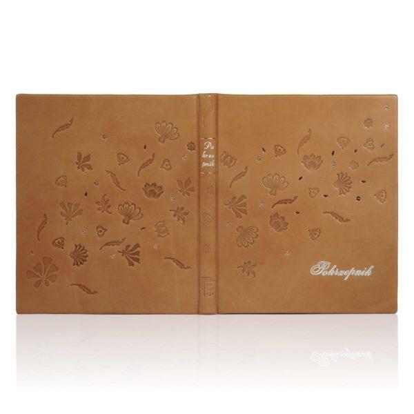 Pięknie tłoczona książka Pokrzepnik